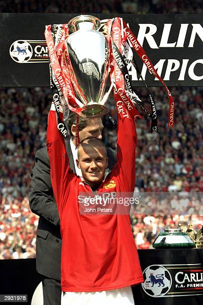 David Beckham celebrates and lifts the FA Premiership trophy after the FA Premiership match between Manchester United v Tottenham Hotspur at Old...