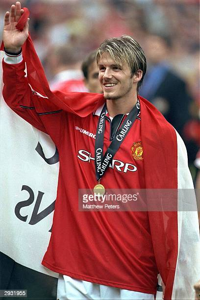 David Beckham celebrates having received his Premiership Winners medal after the FA Carling Premiership match between Manchester United v Tottenham...