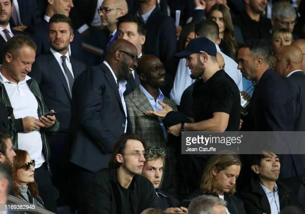 David Beckham Claude Makelele MMA star Khabib Nurmagomedov of Russia Youri Djorkaeff attend the UEFA Champions League group A match between Paris...
