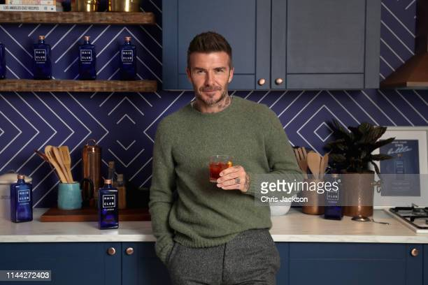 David Beckham enjoys a cocktail at the Haig Club House Party at 19 Greek Street, London, where he surprised guests in attendance on May 17, 2019 in...