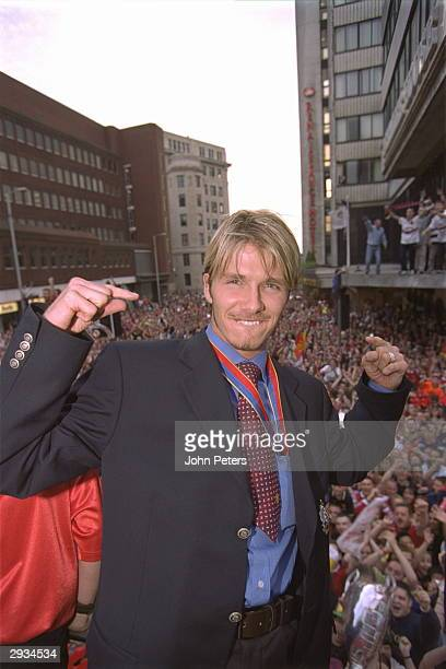 David Beckham enjoys the atmosphere during the Treble Parade in Manchester as Manchester United return after the UEFA Champions League victory of...