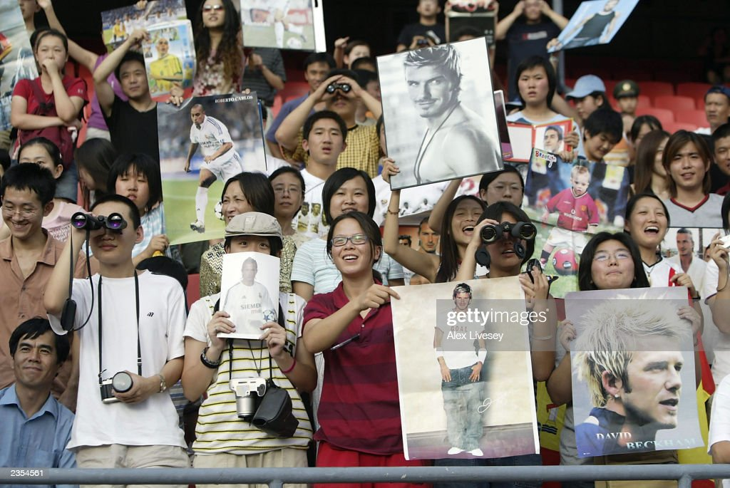 David Beckham fans watch him during a training session on August 1, 2003 at the Workers Stadium in Beijing, China.