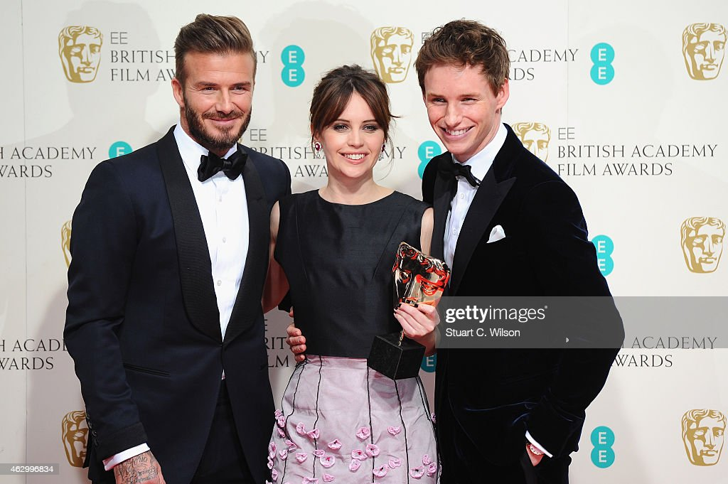 David Beckham, Felicity Jones and Eddie Redmayne pose in the winners room with the award for Outstanding British Film in 2015 for The Theory Of Everything, at the EE British Academy Film Awards at The Royal Opera House on February 8, 2015 in London, England.