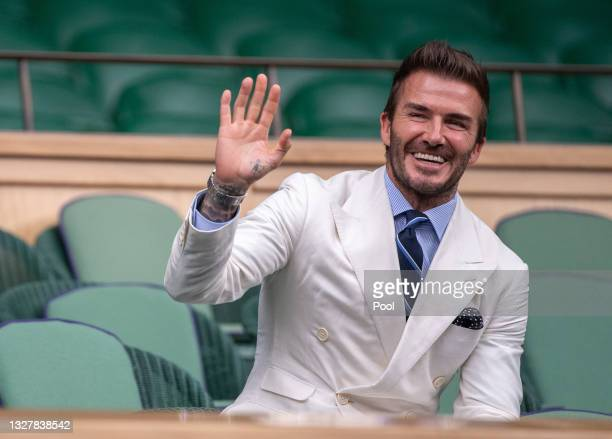 David Beckham, former football player looks on from the Royal Box during the Men's Singles Semi-Final match between Novak Djokovic of Serbia and...