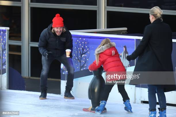 David Beckham gives a big smile as daughter Harper skates towards him at the Natural History Museum Ice Rink The Beckham family had the ice to...