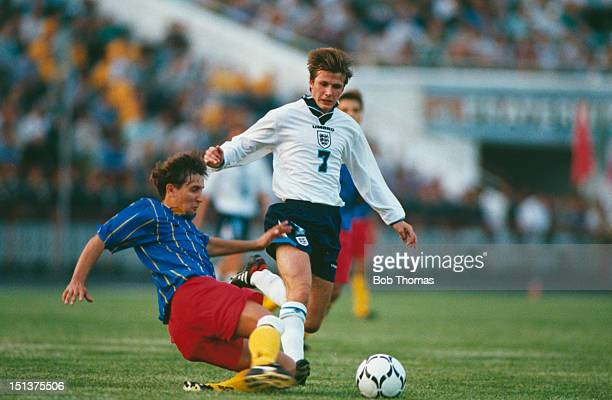 David Beckham goes past a defensive tackle during his England debut at a World Cup Europe Qualifying Round Group 2 match against Moldova Kishinev...