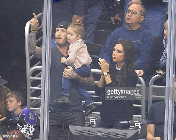 David Beckham Harper Beckham and Victoria Beckham attends a hockey game between the Calgary Flames and the Los Angeles Kings at Staples Center on...