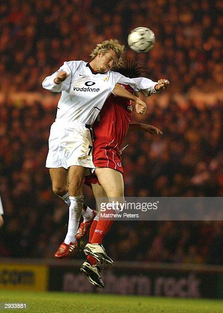 David Beckham heads the ball despite a strong challenge during the FA Barclaycard Premiership match between Middlesbrough v Manchester United at the...