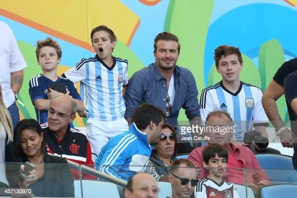 David Beckham his sons Brooklyn Beckham Romeo Beckham Cruz Beckham and Zico attend the 2014 FIFA World Cup Brazil Final match between Germany and...