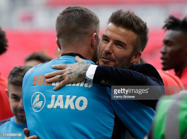 David Beckham hugs Salford players after the Vanarama National League Play Off Final between Salford City and AFC Fylde at Wembley Stadium on May 11,...