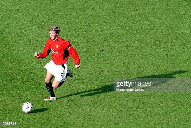 David Beckham in action during the FA Barclaycard Premiership match between Manchester United v Manchester City at Old Trafford on February 9 2003 in...