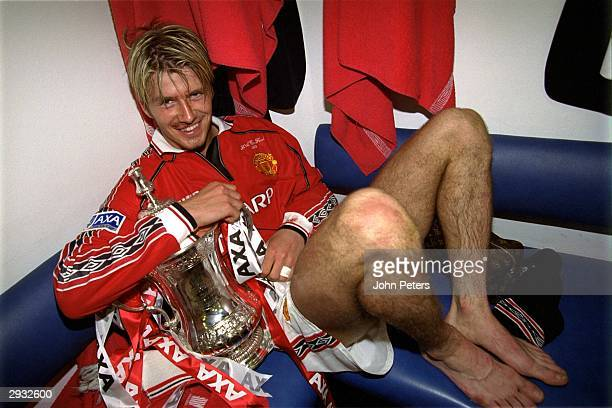 David Beckham in the dressing room with the FA Cup after the FA Cup Final between Manchester United v Newcastle at Wembley Stadium on May 22, 1999 in...