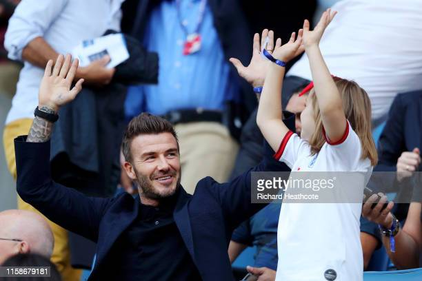 David Beckham is seen in the stands doing a mexican wave with his daughter Harper prior to the 2019 FIFA Women's World Cup France Quarter Final match...