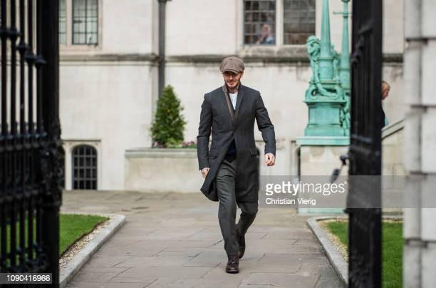 David Beckham is seen outside Kent & Curwen wearing flat cap, wool coat during London Fashion Week Men's January 2019 on January 06, 2019 in London,...