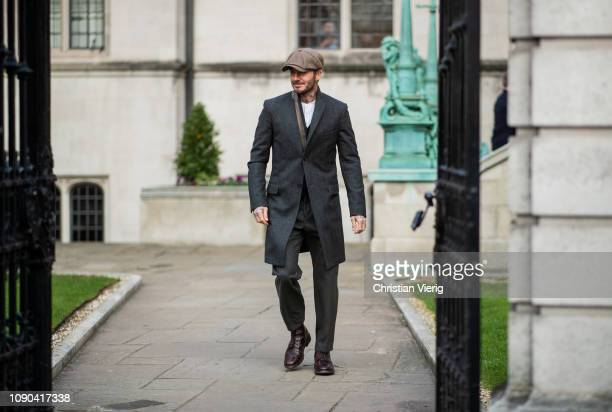 David Beckham is seen outside Kent Curwen wearing flat cap wool coat during London Fashion Week Men's January 2019 on January 06 2019 in London...