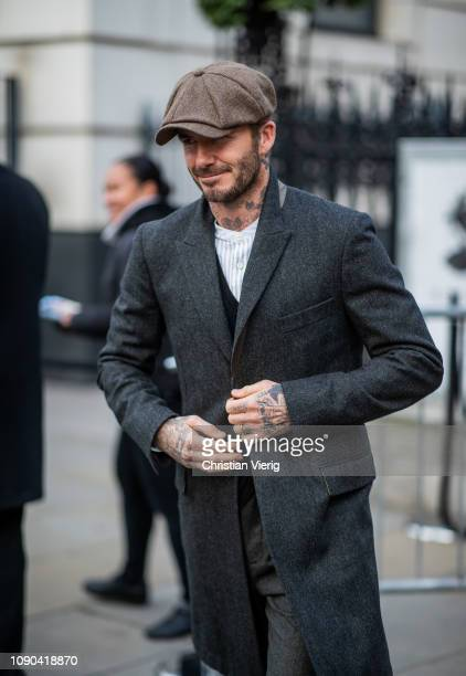 David Beckham is seen outside Kent Curwen wearing flat cap wool coat during  London Fashion Week 696238ac225a