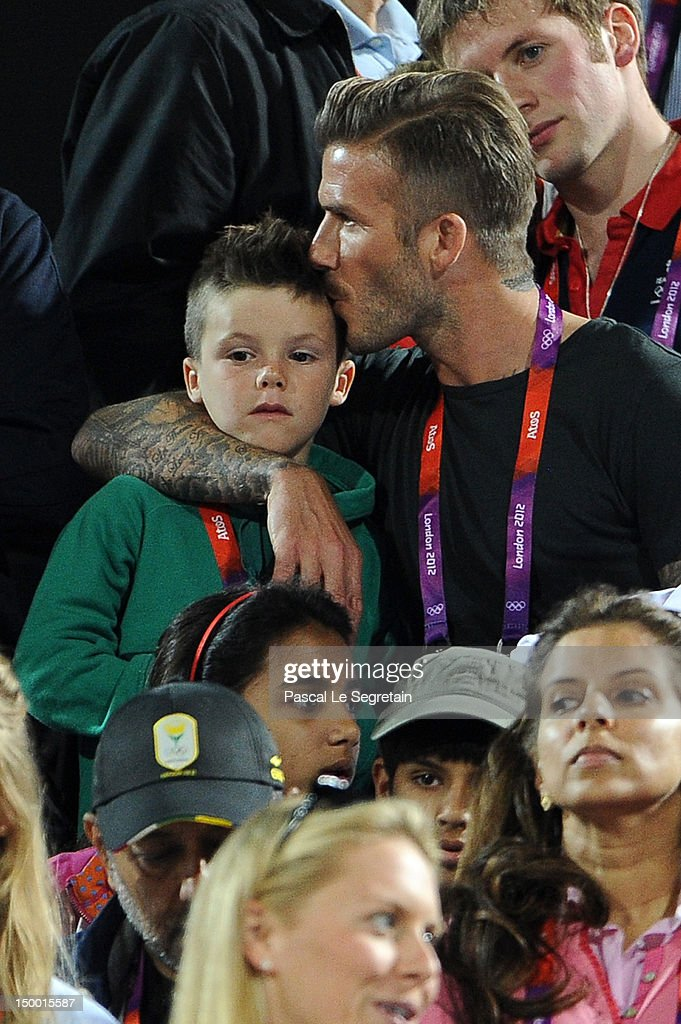 David Beckham (R) kisses his son Cruz Beckham during the Beach Volleyball on Day 12 of the London 2012 Olympic Games at Horse Guards Parade on August 8, 2012 in London, England.
