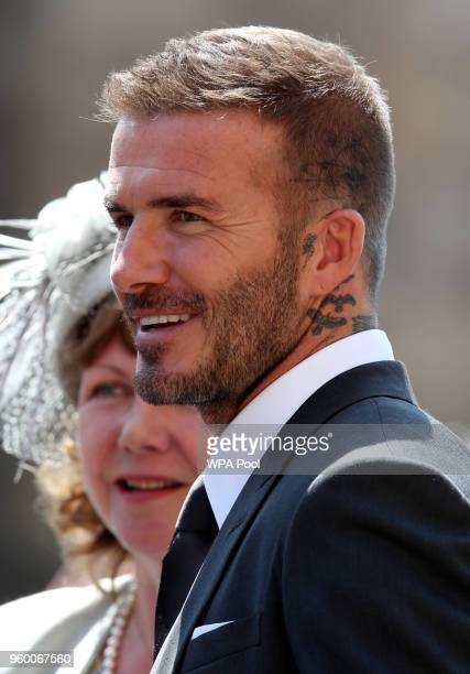 David Beckham leaves St George's Chapel at Windsor Castle after the wedding of Prince Harry to Meghan Markle on May 19 2018 in Windsor England