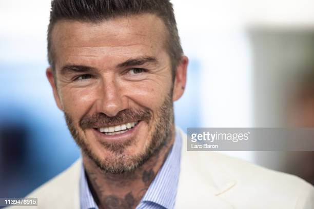 David Beckham looks on from the Red Bull Racing garage before the F1 Grand Prix of Bahrain at Bahrain International Circuit on March 31, 2019 in...