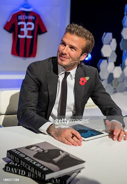 David Beckham meets fans and signs copies of his book as part of a global digital book signing on Facebook at 3pm today on October 30 2013 in London...