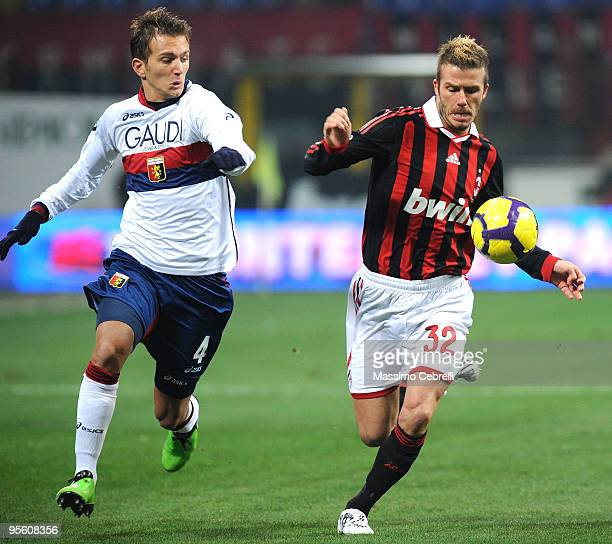 David Beckham of AC Milan battles for the ball against Domenico Criscito of Genoa CFC during the Serie A match between AC Milan and Genoa CFC at...