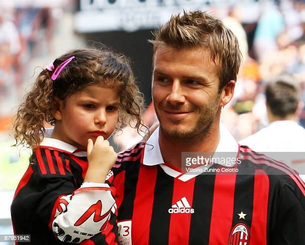 David Beckham of AC Milan carries a young supporter prior to the AC Milan and AS Roma Serie A match at the Stadio Giuseppe Meazza on May 24 2009 in...