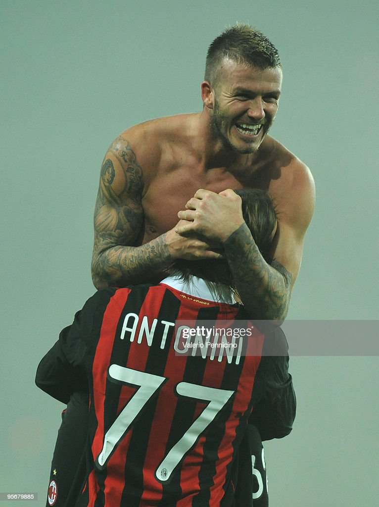 David Beckham of AC Milan celebrate victory with Luca Antonini after the Serie A match between Juventus FC and AC Milan at Stadio Olimpico di Torino on January 10, 2010 in Turin, Italy.