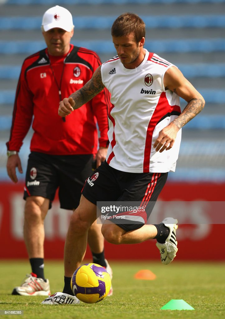 David Beckham (R) of AC Milan in action as Carlo Ancelotti (L), manager of AC Milan, looks on during a training session during the AC Milan Winter Training Camp at the Al Nasr Sports Club on January 4, 2009 in Dubai, United Arab Emirates.