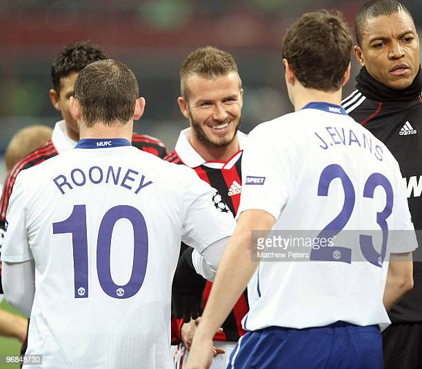 David Beckham of AC Milan shakes hands with Paul Scholes of Manchester United ahead of the UEFA Champions League First KnockOut Round match between...