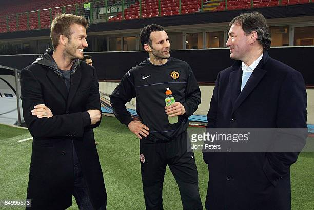 David Beckham of AC MIlan speaks with Ryan Giggs and Bryan Robson of Manchester United during a training session ahead of their UEFA Champions League...