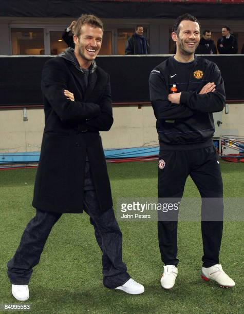 David Beckham of AC MIlan speaks with Ryan Giggs of Manchester United during a training session ahead of their UEFA Champions League QuarterFinal...