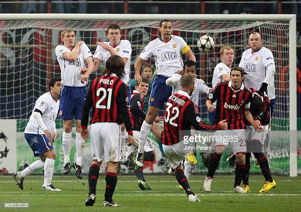 David Beckham of AC Milan takes a freekick during the UEFA Champions League First KnockOut Round match between AC Milan and Manchester United at the...