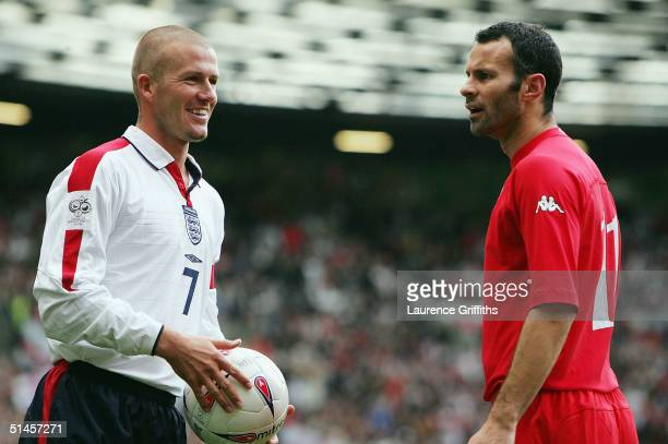 David Beckham of England and Ryan Giggs of Wales share an exchange during the 2006 World Cup Qualifying match between England and Wales at Old...