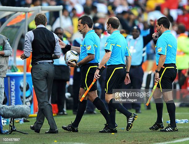 David Beckham of England asks referee Jorge Larrionda about the incident where the ball crossed the line during the 2010 FIFA World Cup South Africa...