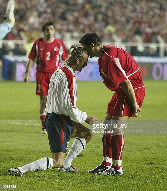 David Beckham of England attempts to knock heads with Alpay Ozalan of Turkey after David Beckham missed a penalty during the UEFA European...