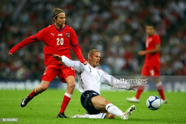 David Beckham of England battles for the ball with Jaroslav Plasil of Czech Republic during the international friendly match between England and the...