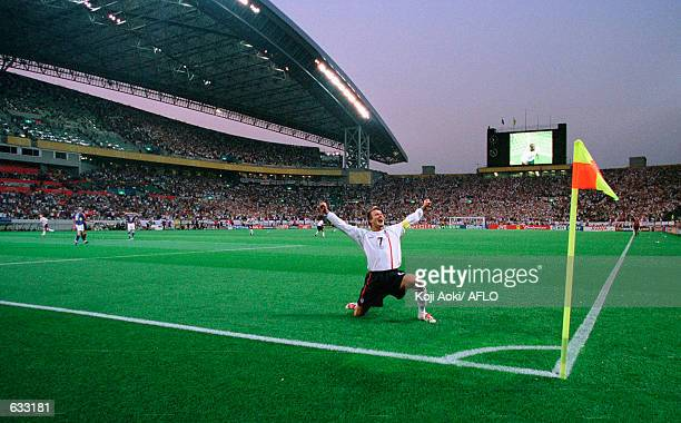 David Beckham of England celebrates after his corner led to the first goal during the England v Sweden, Group F, World Cup Group Stage match played...