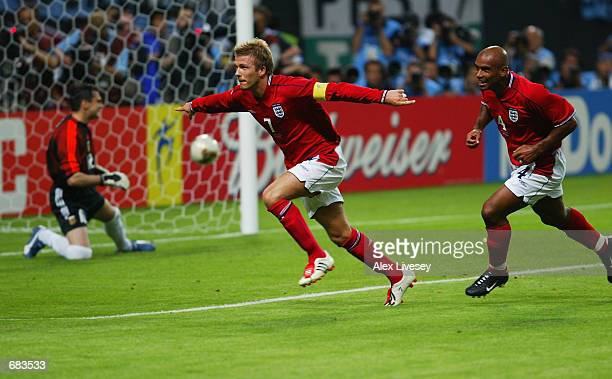 David Beckham of England celebrates after scoring the opening goal during the England v Argentina, Group F, World Cup Group Stage match played at the...