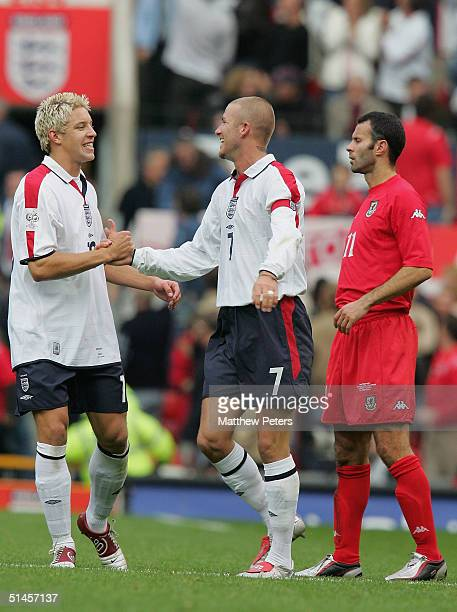 David Beckham of England celebrates scoring the second goal with Alan Smith while Ryan Giggs of Wales looks on during the England v Wales World Cup...