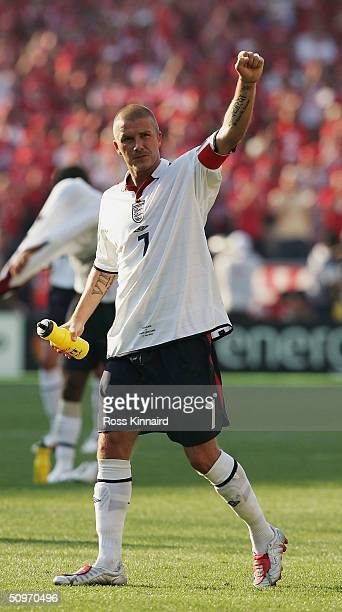 David Beckham of England celebrates their victory during the UEFA Euro 2004 Group B match between England and Switzerland at the Estadio Cidade de...