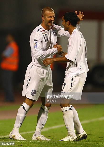 David Beckham of England congratulates team mate Theo Walcott on his hat-trick, as he comes on as a substitute during the FIFA 2010 World Cup...