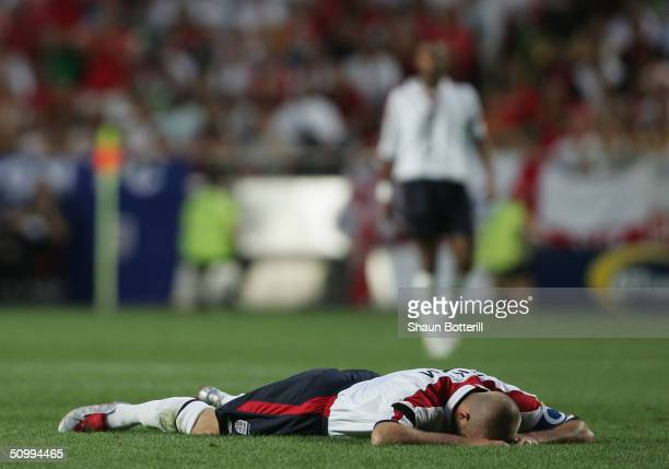 David Beckham of England down on the ground during the UEFA Euro 2004 Quarter Final match between Portugal and England at the Luz Stadium on June 24...