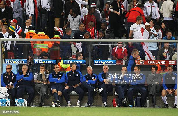 David Beckham of England Fabio Capello manager of England and Stuart Pearce of England look on dejected after the 2010 FIFA World Cup South Africa...