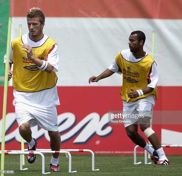 David Beckham of England followed by Ashley Cole during the teams training session at the Sano Park training centre in Tsuna Town on Awaji Shima...