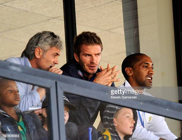 David Beckham of England follows the action in the pitch between Australia and USA during the 2010 FIFA World Cup PreTournament match between the...