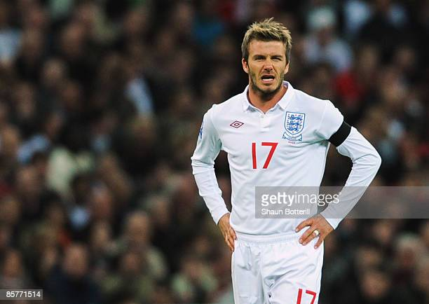 David Beckham of England grimaces during the FIFA 2010 World Cup Group 6 Qualifying match between England and Ukraine at Wembley Stadium on April 1...