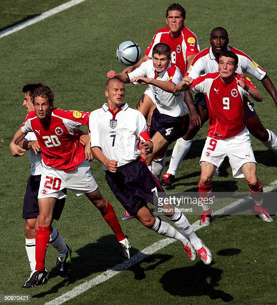 David Beckham of England is challenged by Patrick Muller of Switzerland during the UEFA Euro 2004 Group B match between England and Switzerland at...