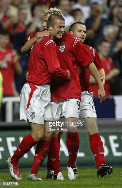 David Beckham of England is congratulated by Alan Smith and Michael Owen after scoring the first goal during the International friendly match between...