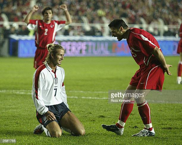 david beckham of england is taunted by alpay ozalan of turkey after he missed a penalty