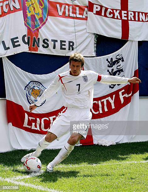 David Beckham of England kicks the ball in from the corner in the first half of the game against Colombia during the game at Giants Stadium on May 31...